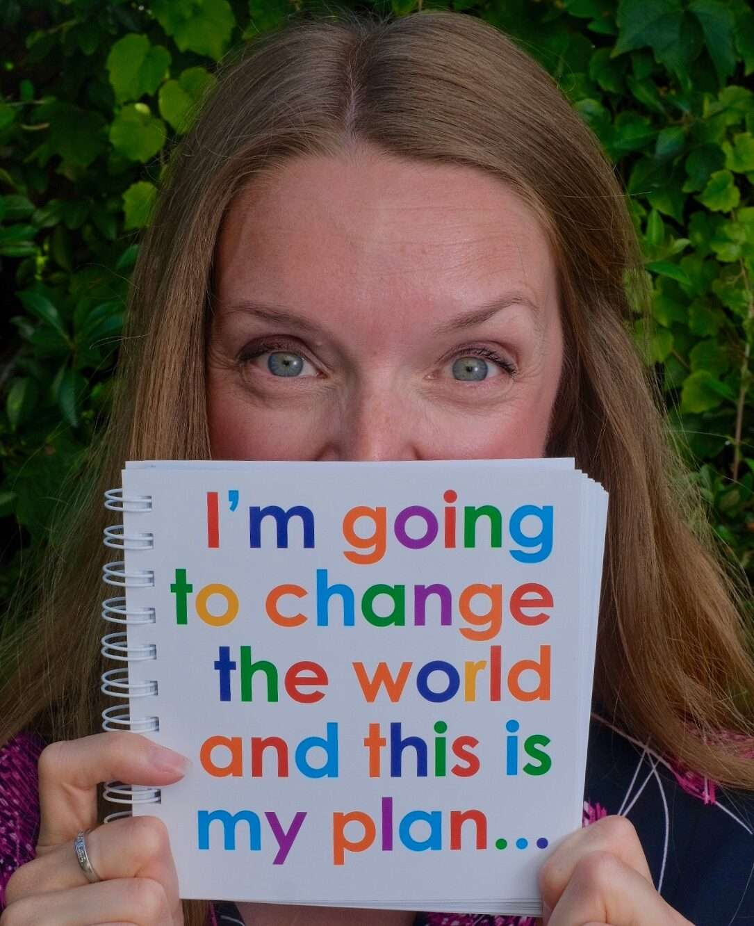 Founder of not only pink and blue Clare Willetts with note book saying I'm going to change the world and this is my plan.